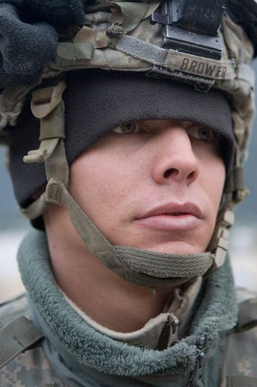 """Chad Hunt, """"I enjoyed my first fire-fight so mouch I re-enlisted for six more years the next day,"""" SPC Corey Brower, 21, Huntington Beach, CA, The Korengal Outpost, Afghanistan"""
