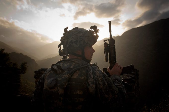 Chad Hunt, Soldier with gun in sillouette, Captain McKnight, The Korengal Valley, The Korengal Outpost, Afghanistan