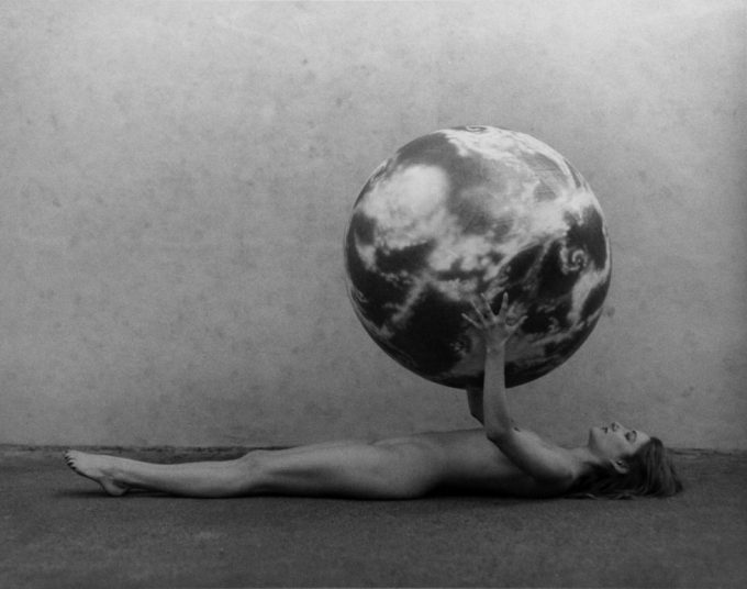 Spencer Tunick, Nude Woman with Model of the Earth, Photograph