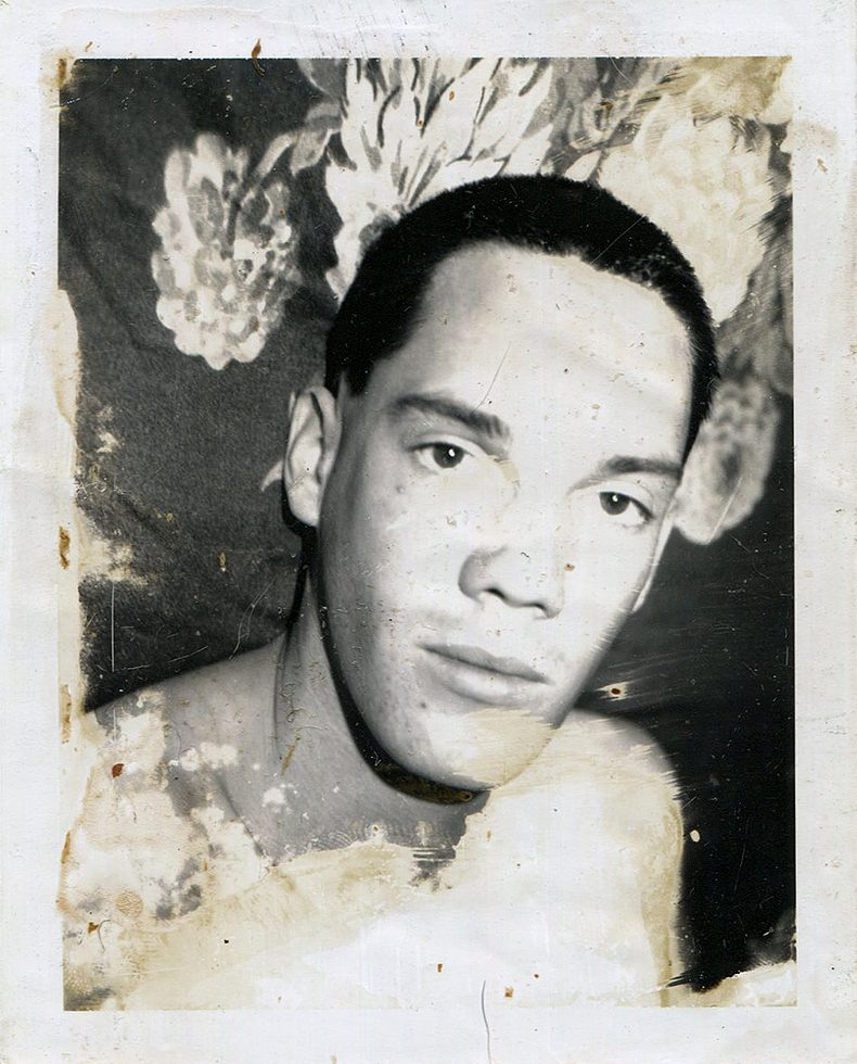Untitled (Close Up of Robert in Front of Floral Fabric)