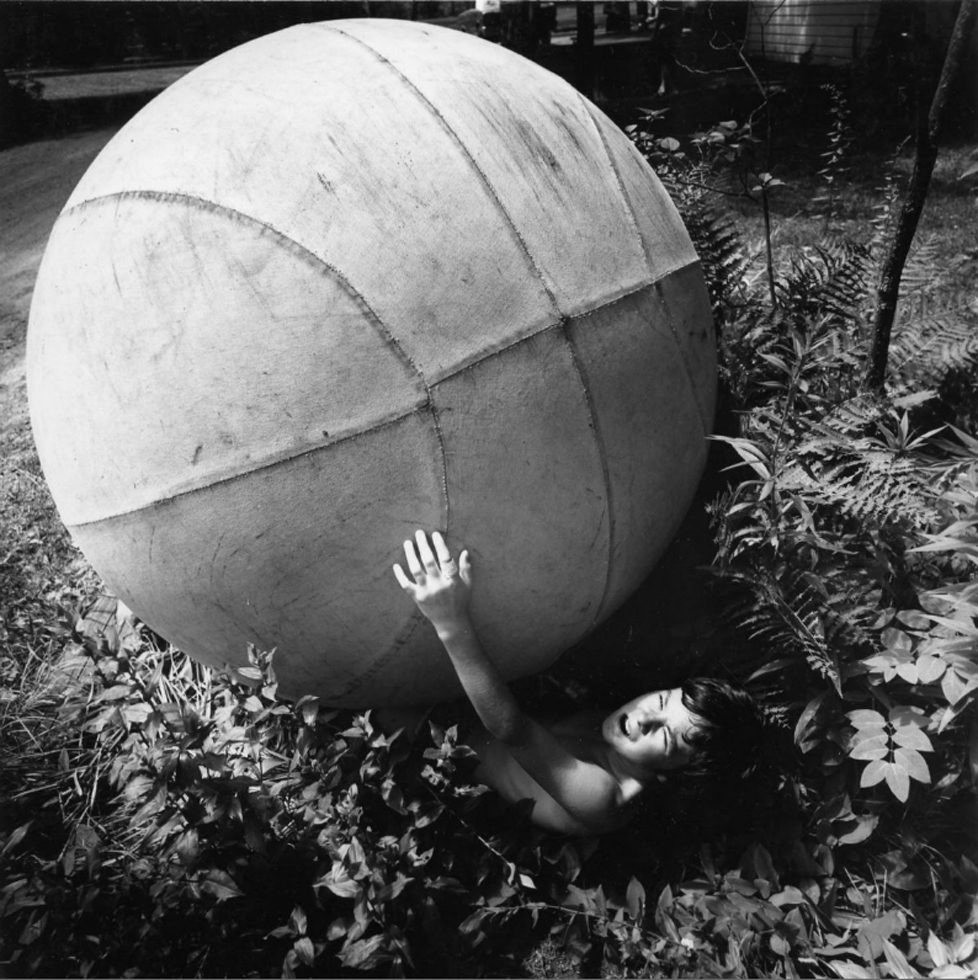 Boy with Giant Ball
