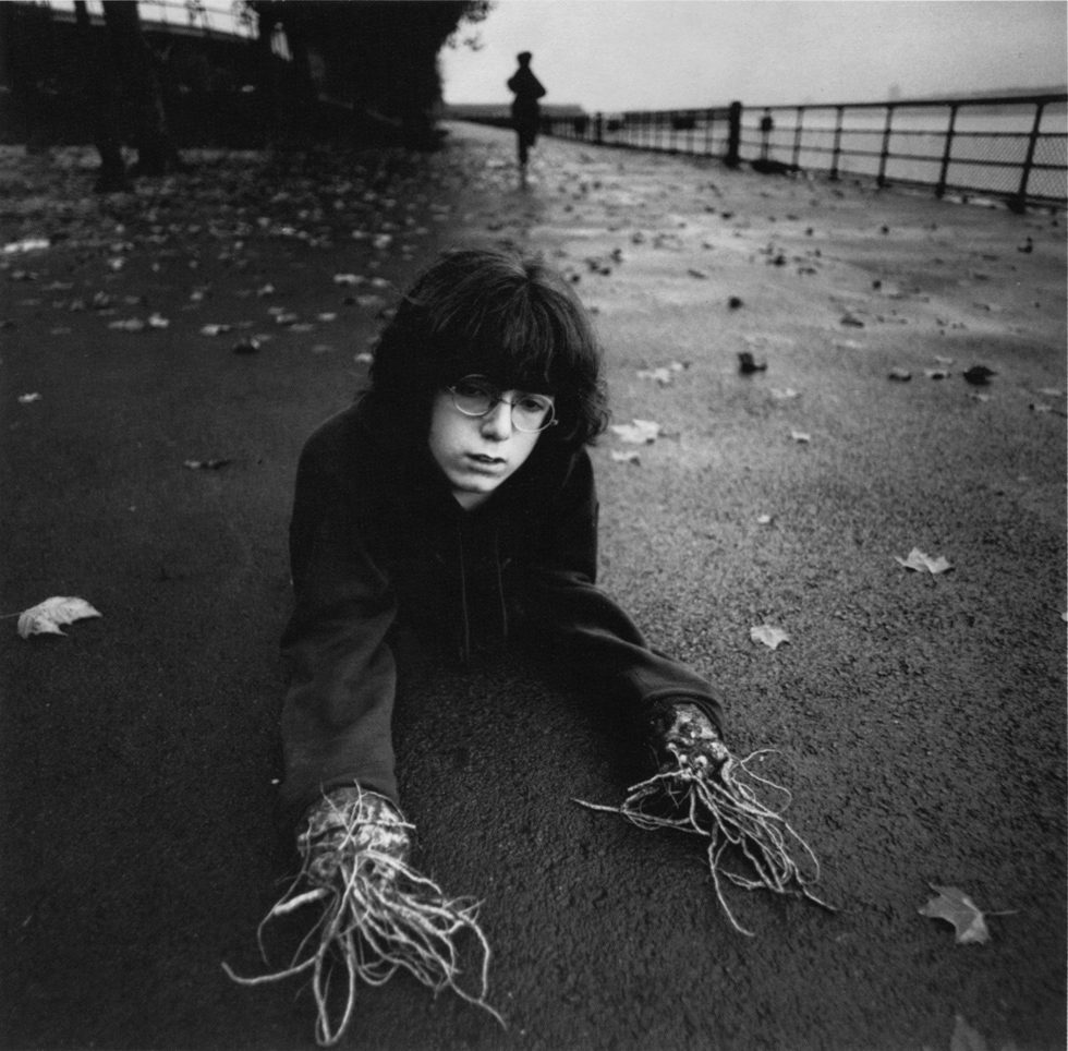 Boy with Root Hands