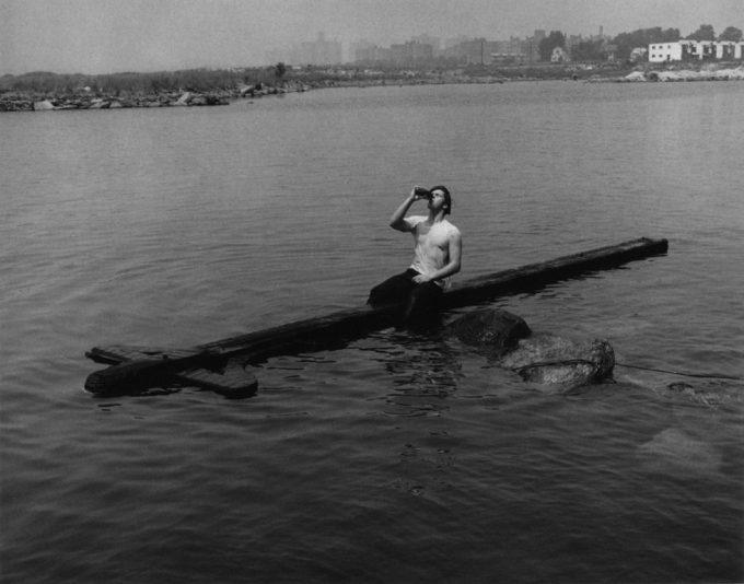 Arthur Tress, Teenager Drinking on Telephone Pole