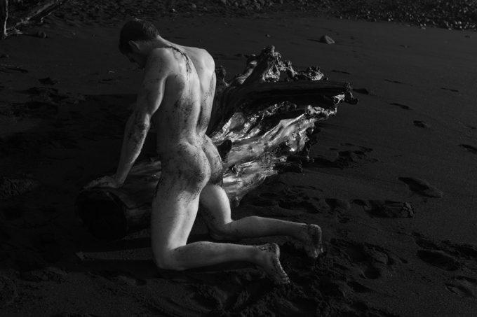 Nick Turner, Untitled (Kneeling by Driftwood)