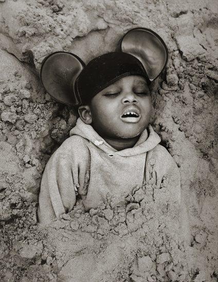 Arthur Tress, Boy in Mickey Mouse Hat, Coney Island, New York